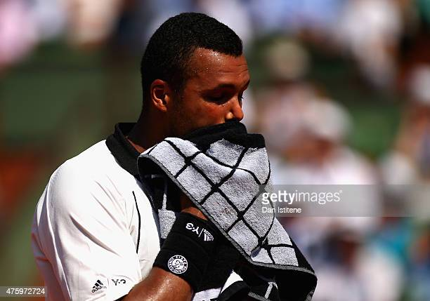 JoWilfried Tsonga of France wipes his face with a towel in his Men's Semi Final match against Stanislas Wawrinka of Switzerland on day thirteen of...