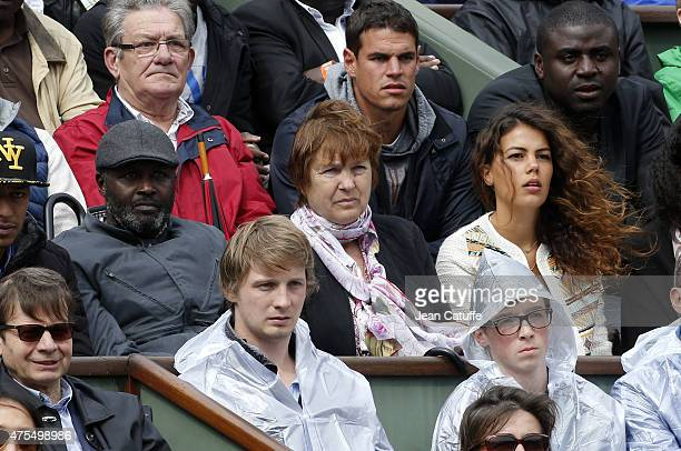 JoWilfried Tsonga parents' Didier Tsonga and Evelyne Tsonga and his girlfriend Noura El Shwekh attend day 8 of the French Open 2015 at Roland Garros...