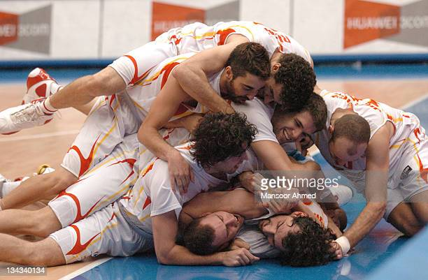 Joy as Spainish players pile on top one another as they beat Argentina to reach the final of the FIBA World Championship 2006 at the Saitama Super...