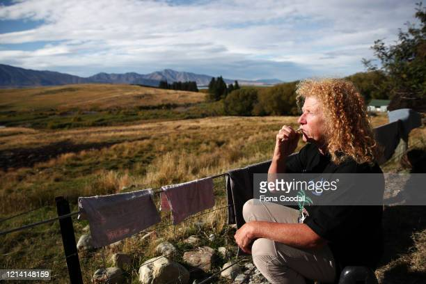 Joy Bell cleans her teeth in the solitude of Godley Peaks Station in the South Island's Mackenzie Country on March 23, 2020 in Lake Tekapo, New...