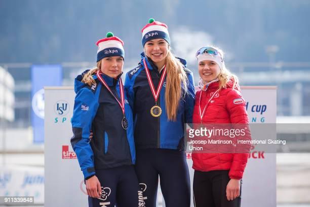 Joy Beune and Jutta Leerdam of Netherlands and Karolina Bosiek of Poland pose in the Ladies 1500m medal ceremony during day two of the ISU Junior...