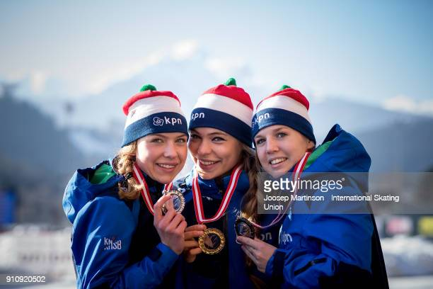 Joy Beune, Jutta Leerdam and Elisa Dul of Netherlands pose in the Ladies 1000m medal ceremony during the ISU Junior World Cup Speed Skating at...