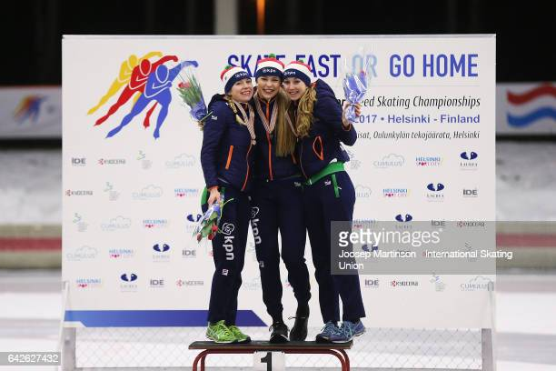 Joy Beune Jutta Leerdam and Sanne In 't Hof of Netherlands pose in the overall classification medal ceremony during day two of the World Junior Speed...