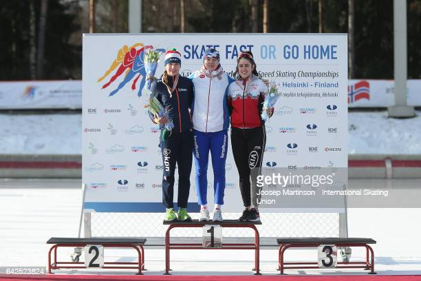 Joy Beune of Netherlands Daria Kachanova of Russia and Beatrice Lamarche of Canada pose in the ladies 1000m medal ceremony during day two of the...