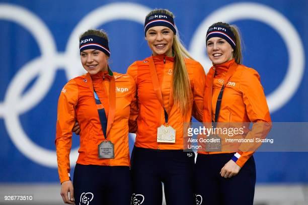 Joy Beune of the Netherlands Jutta Leerdam of the Netherlands and Elisa Dul of the Netherlands stand on the podium after winning the women's 1000...
