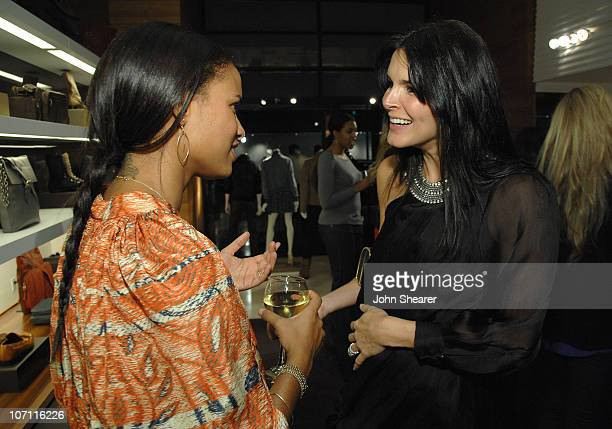 Joy Bryant and Angie Harmon at the Vogue and Step Up Women's Network fashion event at Bally on October 28 2008 in Beverly Hills California
