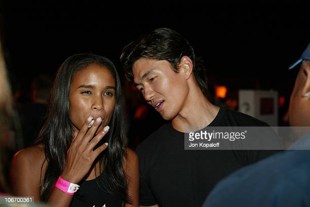 Joy Bryant and Rick Yune during TMobile Action Sports Team Hosts ActionPacked Inside Party at ArcLight Cinema Rooftop in Hollywood California United...
