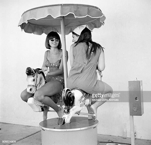Joy Calig 17 of San Fernando Valley rides a little child ride wearing sun glasses mad popular by Jim McGuinn leader of the rock n roll group The...