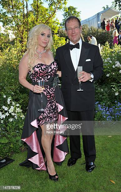 Joy Canfield and Richard Desmond poses at The 14th Annual White Tie and Tiara Ball to Benefit Elton John AIDS Foundation in Association with Chopard...