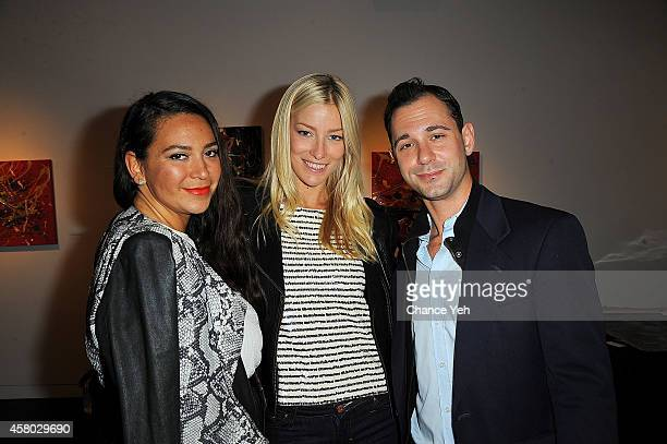 Joy Cioci Amy Ruby and Jonathan Tchaikovsky attend Aelita Andre Exhibit Opening Night at Gallery 151 on October 28 2014 in New York City