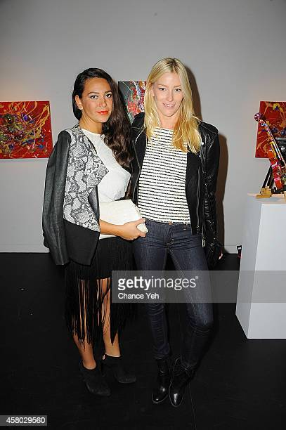 Joy Cioci and Amy Ruby attend Aelita Andre Exhibit Opening Night at Gallery 151 on October 28, 2014 in New York City.