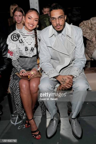 Joy Crookes and AJ Tracey attend the Burberry Autumn/Winter 2020 show during London Fashion Week at Kensington Olympia on February 17 2020 in London...