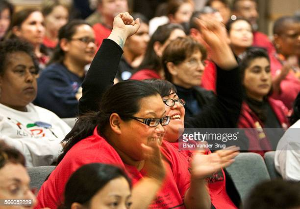 Joy Duenez right and Barbara Torres react as the school board votes for a plan they support at LAUSD school board meeting Tuesday February 23 2010
