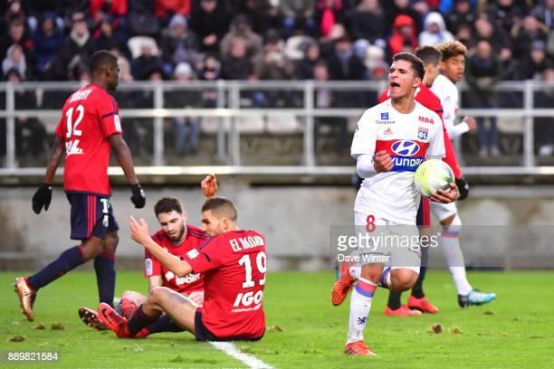 Joy for Houssem Aouar of Lyon as he scores a late equaliser during the Ligue 1 match between Amiens SC and Olympique Lyonnais at Stade de la Licorne...