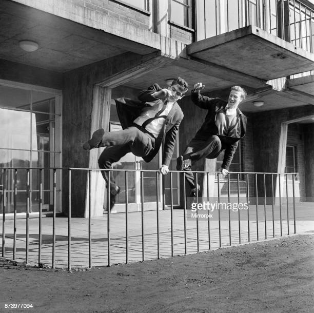 Joy for Leeds United pair Jackie Charlton and Norman Hunter after being chosen to play for the England league team Here they arrive at Elland Road to...