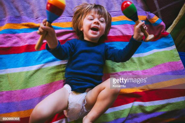 joy in bed - diaper boy stock photos and pictures