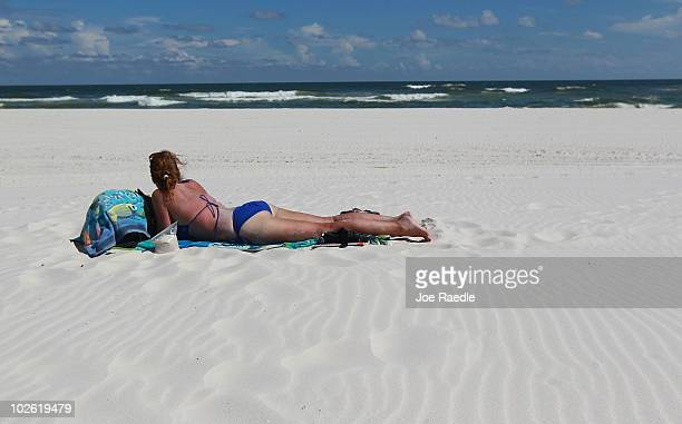 Joy Laux on vacation from Missouri enjoys an empty beach as people stayed away due to the threat of contamination from the Deepwater Horizon oil...