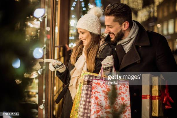 joy of buying christmas gifts - christmas shopping stock photos and pictures