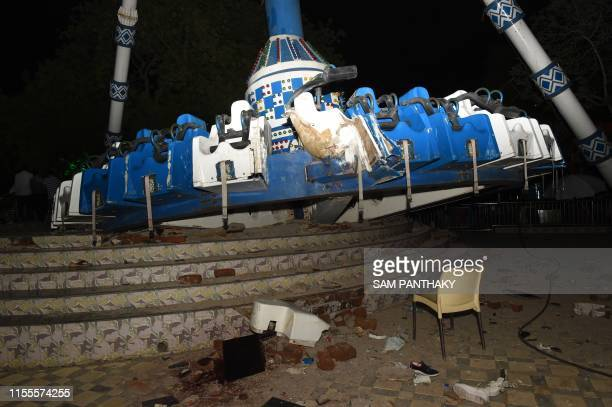 Joy Ride machine known as 'Discovery' is pictured after crashing at Kankaria Lake Front in Ahmedabad on July 14 2019 At least two visitors have died...