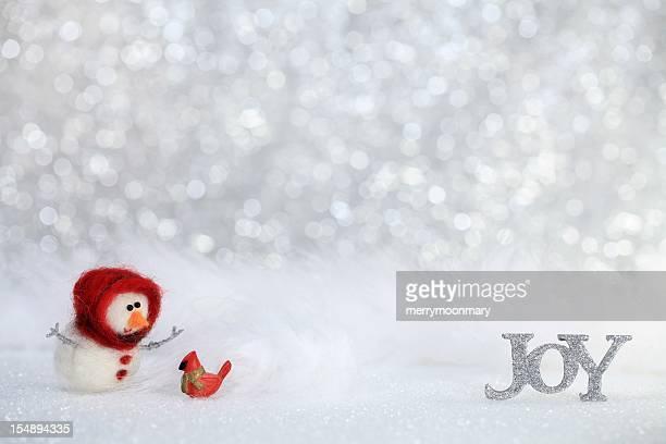 joy snowman with cardinal - cardinal bird stock photos and pictures