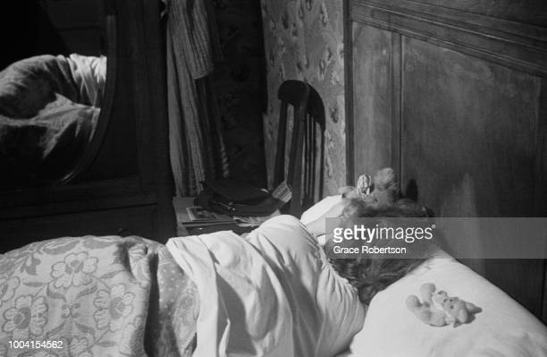 Joy the head girl of a Bluebell Girls dance troupe sleeping in her room at the Hotel Riboute in Paris November 1951 She and the rest of the troupe...