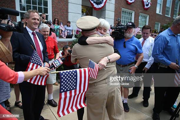 Joy Thomson hugs US Navy Chief Petty Officer Keith Jermyn of Hingham Jermyn returned home to Hingham where he is the Director of Veterans Services...