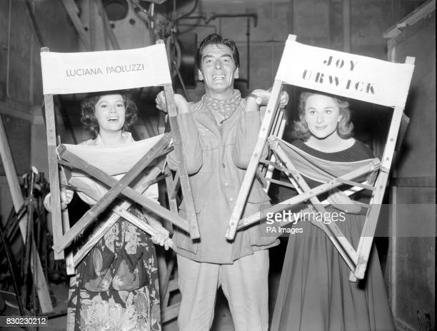 Joy Urwick makes a happy trio with Itallian actress Lucciana Paoluzzi and Hollywoods Victor Mature at the MGM Studios Boreham Wood Hertfordshire for...