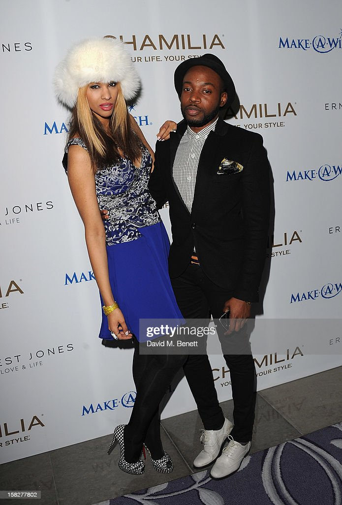 Joy Vieli (L) and Fat Tony attend a champagne reception celebrating the launch of Chamilia and Ernest Jones' partnership with Make-A-Wish International at the Corinthia Hotel on December 12, 2012 in London, England.
