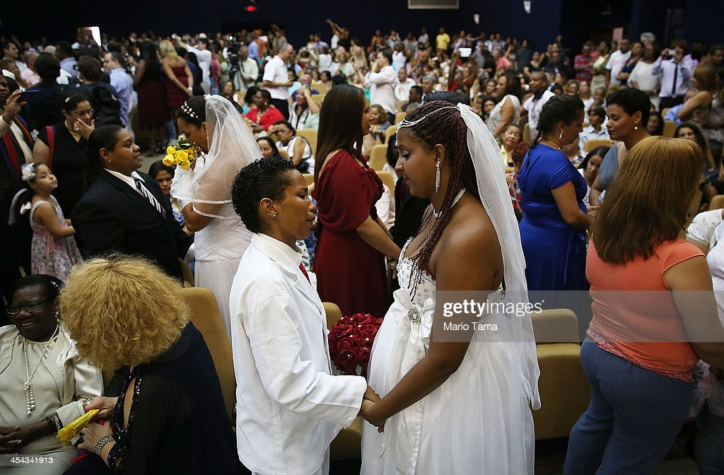 Joyce and Gabrieli (R) hold hands at what was billed as the world's largest communal gay wedding on December 8, 2013 in Rio de Janeiro, Brazil. 130 couples were married at the event which was held at the Court of Justice in downtown Rio. In May, Brazil became the third country in Latin America to effectively approve same-sex marriage via a court ruling, but a final law has yet to be passed.