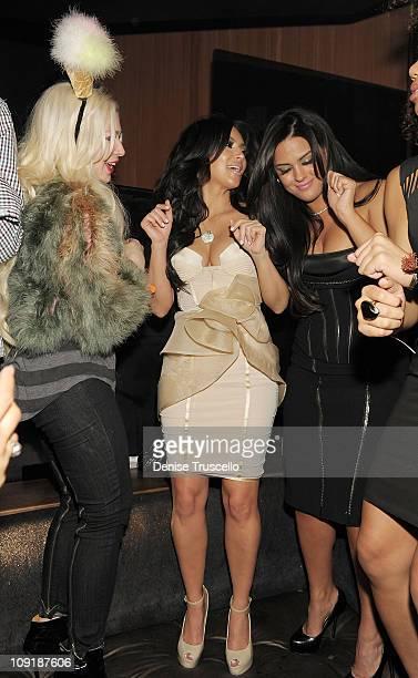 Joyce Bonelli Kim Kardashian and Carla DiBello attend Marquee nightclub at the Cosmopolitan on February 14 2011 in Las Vegas Nevada
