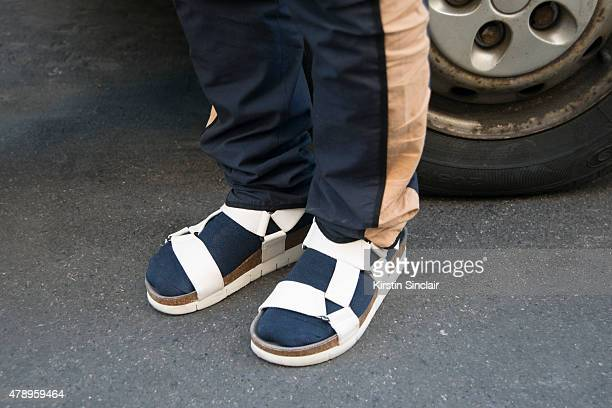 Joyce buyer Michael Mok wears Dries Van Noten trousers and Marc Jacobs shoes on day 2 of Paris Collections Men on June 25 2015 in Paris France