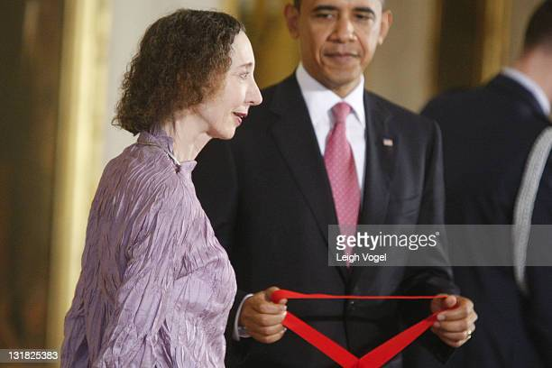 Joyce Carol Oates and Barack Obama attend the 2010 National Medal of Arts and National Humanities Medal at White House on March 2 2011 in Washington...