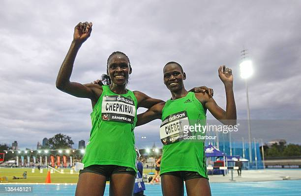 Joyce Chepkirui and Emily Chebet of Kenya celebrate after the Zatopek 10 Womens 10000m during the 2011 Zatopek Classic at the Victorian Athletics...