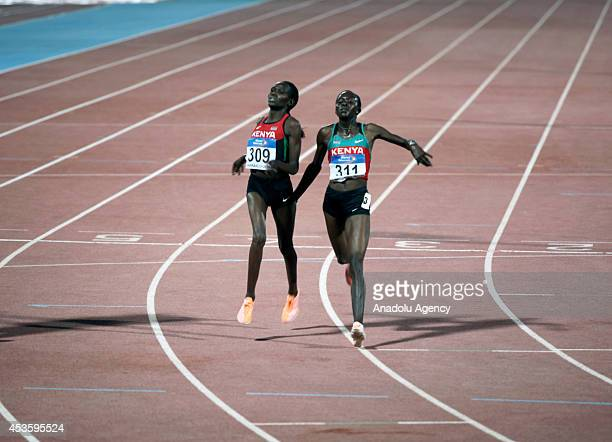 Joyce Chepkirui of Kenya and Emily Chebet compete at the women's 10000m field on the day three of African championships at the Grande Stade de...