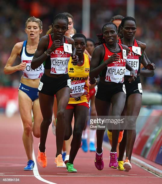 Joyce Chepkirui of Kenya Florence Kiplagat of Kenya and Emily Chebet of Kenya compete in the Women's 10000 metres final at Hampden Park during day...