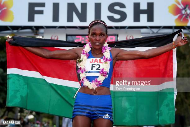 Joyce Chepkirui of Kenya poses with a flag after finishing third in the Women's division of the Honolulu Marathon 2017 on December 10 2017 in...
