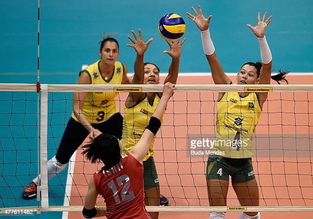 Joyce da Silva and Ana Carolina da Silva of Brazil block the ball during the Brazil v Japan Volleyball Challenge at Maracanazinho on June 18 2015 in...