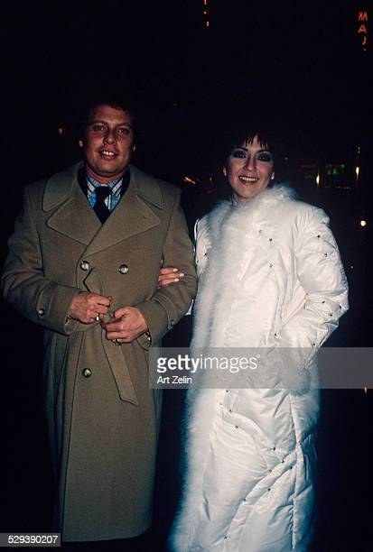 Joyce DeWitt in a white fur trimmed down coat with a friend circa 1970 New York