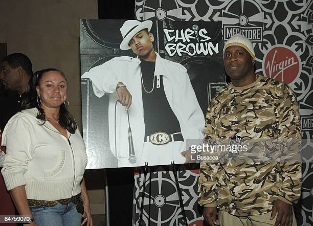 Joyce Hawkins and Clinton Brown Chris Brown's mother and father with poster of Chris Brown