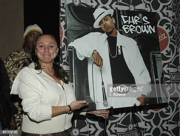 Joyce Hawkins Chris Brown's mother with poster of Chris Brown