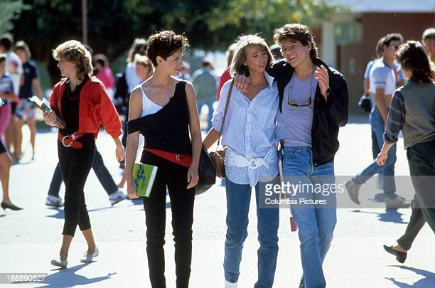 Joyce Hyser walks with Billy Jayne and his girlfriend in a scene from the film 'Just One Of The Guys' 1985
