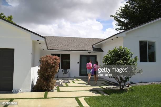 Joyce Lara and Joan Glenny who are representatives of Planned Parenthood approach a home as they canvass a neighborhood to educate people about the...