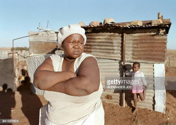 Joyce Mananki mother of murdered child activist Stompie Moeketsi Seipei stands in front of her tin shack 18 September 1990 at Tumahole township south...