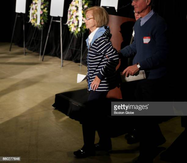 Joyce Spector Mekelburg is helped back to her seat after giving remarks at an event marking the 75h anniversary of the Cocoanut Grove fire at the...