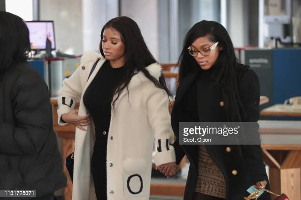 Joycelyn Savage and Azriel Clary arrive for a bond hearing for R&B singer R. Kelly at the Leighton Criminal Court Building on February 23, 2019 in...