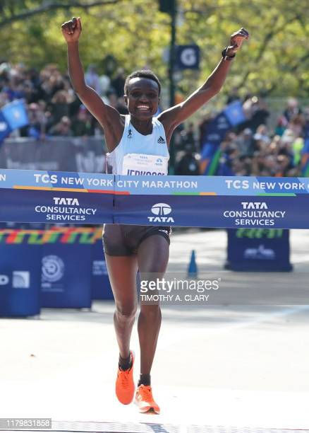 Joyciline Epikouros of Kenya crosses the finish line to win the Professional Women's Finish during the 2019 TCS New York City Marathon in New York on...