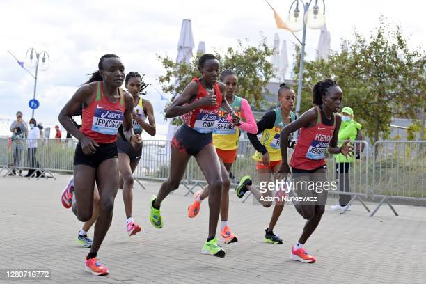 Joyciline Jepkosge of Kenya, Yasemin Can of Turkey and Peres Jepchirchir of Kenya compete in the Women's Final run during the World Athletics Half...