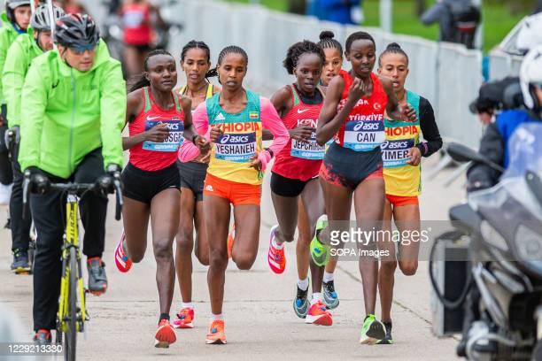 Joyciline Jepkosgei of Kenya Ababel Yeshaneh of Ethiopia Peres Jepchirchir of Kenya in action during 2020 IAAF World Half Marathon Championships in...