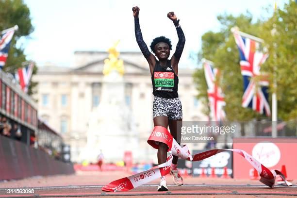 Joyciline Jepkosgei of Kenya celebrates winning the Women's Elite Race during the 2021 Virgin Money London Marathon at Tower Bridge on October 03,...