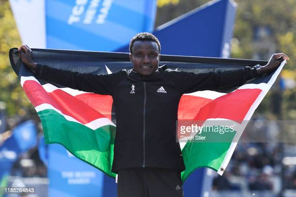 Joyciline Jepkosgei of Kenya poses with the Kenyan flag after winning the Womens' Division of the 2019 TCS New York City Marathon on November 03 2019...